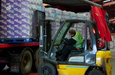 A UniCarriers counterbalance truck loads pallets into a lorry at Boughey Distribution