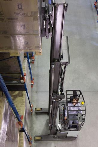 A UniCarriers UHD reach truck places a pallet at a high level