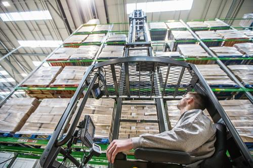 UniCarriers UHX reach truck working in an aisle