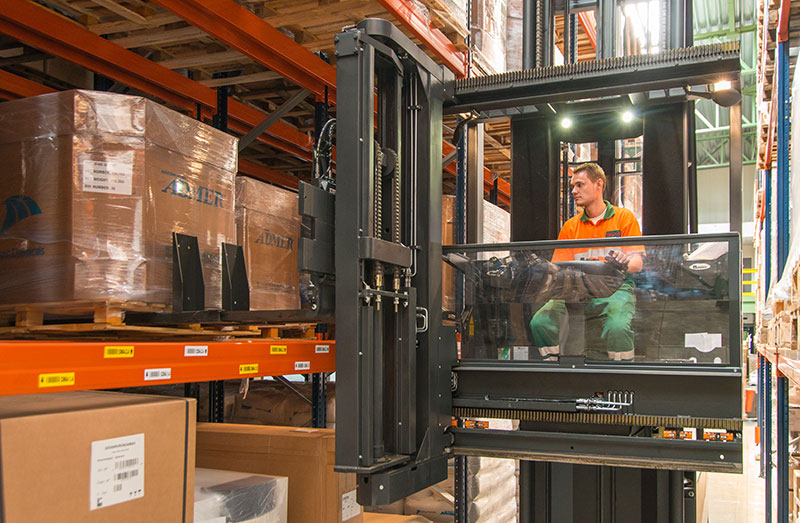 Man-up VNA forklift truck working in aisle